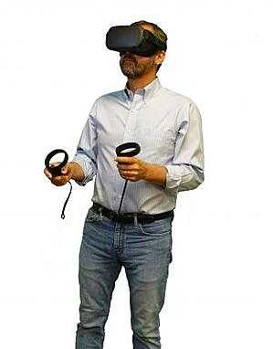 VR for Diversity Training - image of a person using a VR headset and hand controllers